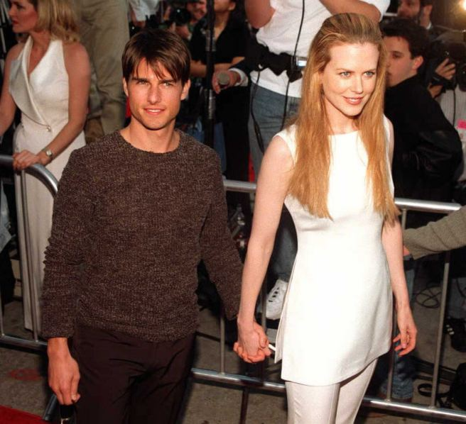 US actor Tom Cruise (L) arrives with his actress-w